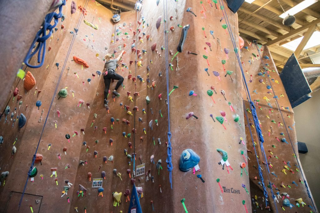 Indoor climbing blonde girl BLUE RIDGE MOUNTAIN GETAWAY
