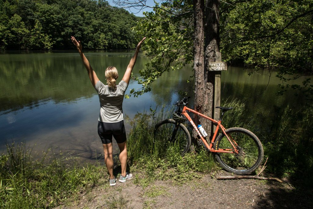 BLUE RIDGE MOUNTAIN GETAWAY Biking Carvin's Cove girl by the lake